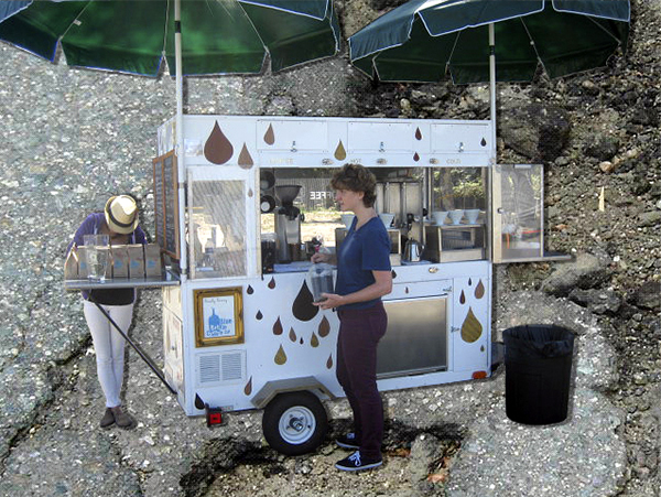 The Drip Bar cart. A narrow frame trailer with electrical outlet, refrigerator, propane hot water tower.